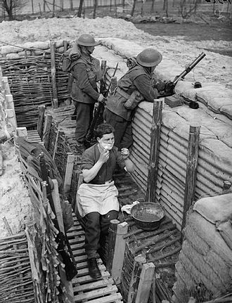 Sherwood Foresters - Men of 'D' Company of the 2nd Battalion, Sherwood Foresters in a forward trench near Roches, 1 April 1940. Lance Corporal L. J. Harris has a shave while other men keep watch, one armed with a 2-inch mortar.