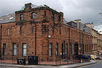 Drill hall - The former drill hall of the 5th/6th Battalion, The Highland Light Infantry at Garnethill, Glasgow, which formed the 52nd Lowland Volunteers in 1967. It is now known as the Haldane Building and is used by the Glasgow School of Art.