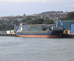 "The MV ""BLUE BAY"" unloading bulk cargo in the Port of Teignmouth on 17th August 2012.jpg"