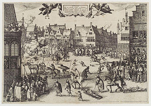 A busy urban scene. Medieval buildings surround an open space, in which several men are being dragged by horses. One man hangs from a scaffold. A corpse is being hacked into pieces. Another man is feeding a large cauldron with a dismembered leg. Thousands of people line the streets and look from windows. Children and dogs run freely. Soldiers keep them back.