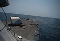 The littoral combat ship USS Freedom (LCS 1) fires 57 mm rounds at a surface target in the Strait of Singapore July 31, 2013 130731-N-JN664-350.jpg