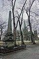 Thomas Angell (1692–1767) minnesmerke obelisk 1895 bust monument architect Karl Norum sculptor Carl Ludvig Jacobsen (orginal Hans Michelsen) Nidaros Cathedral Bispegata Trondheim Norway 2019-03-20 bare trees wet rainy grey etc 09699.jpg