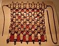 Tibet, nepal o bhutan, grembiule cerimoniale buddista, in osso, cotone, dischi di metallo e campanelle, xix secolo.jpg