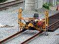 Tie machine, Littleton station, July 2013.JPG