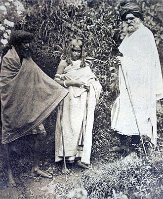 Toda people - Photograph of two Toda men and a woman. Nilgiri Hills, 1871.