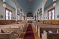 Toutes Aides Roman Catholic Church - pews from rear.jpg