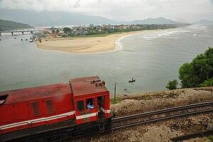 North–South Railway (Vietnam) - A locomotive drives past Lăng Cô.