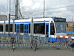 Tram 25 near Central Station Amsterdam, direction Passengers Terminal along the waterside of IJ, 2006.jpg