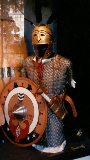 Triarii - Replica triarius metal mail armor, gladius and shield on display at the Flavian Amphitheater, Rome, Italy