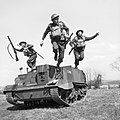 Troops of the 2nd Monmouthshire Regiment leap from their Universal carrier during an exercise near Newry in Northern Ireland, 26 April 1941. H9234.jpg
