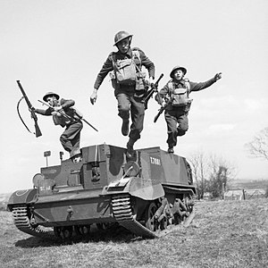 Monmouthshire Regiment - Men of the 2nd Monmouthshire Regiment, part of the 160th Infantry Brigade of the 53rd (Welsh) Infantry Division, leap from their Universal Carrier during an exercise near Newry in Northern Ireland, 26 April 1941.