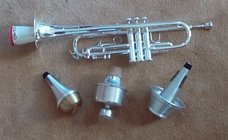Trumpet - Trumpet with paper straight mute inserted; below are (left to right) straight, wah-wah (Harmon), and cup mutes.