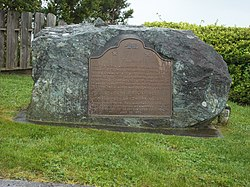 This stone marker and plaque mark the former location of the indigenous Yurok settlement of Tsurai/Tsuaru.