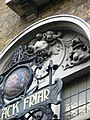 Two Imps blow horns in the tympanum of the Black Friar.JPG