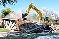 U.S. Air Force Tech. Sgt. Carl White Jr., with the 147th Civil Engineer Squadron (CES), Texas Air National Guard, operates heavy equipment to demolish a drug house in Harlingen, Texas, Dec. 16, 2013 131216-Z-BQ644-005.jpg