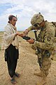 U.S. Army Spc. Jordon Purgat, right, assigned to the 1st Battalion, 187th Infantry Regiment, fingerprints an Afghan villager during Operation Shamshir VI in Khoti Kheyl, Zormat district, Afghanistan, May 7 130507-A-NQ567-038.jpg