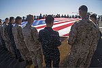 U.S. Marines and Sailors assigned to the 26th Marine Expeditionary Unit (MEU), and Sailors assigned to the USS Kearsarge (LHD 3), hold the American flag to commemorate the Fourth of July during their 2013 130704-M-BS001-002.jpg