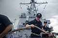 U.S. Naval Academy Midshipman 3rd Class Keegan Kush, center, participates in a sea and anchor detail aboard the guided missile destroyer USS John S. McCain (DDG 56) in the Philippine Sea June 28, 2014, during 140628-N-UN259-023.jpg