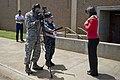 U.S. Navy Mass Communication Specialist 1st Class Cynthia Clark, center, and Air Force Tech. Sgt. Michael Jackson, left, both broadcast journalists with the American Forces Network-Pacific Hawaii News Bureau 130329-F-MQ656-101.jpg