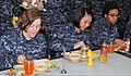 U.S. Navy recruits eat lunch inside the USS Triton recruit barracks' galley at Recruit Training Command at Naval Station Great Lakes, Ill. 121031-N-IK959-338.jpg