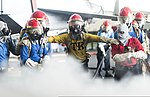 U.S. Sailors fight a simulated fire during a general quarters drill in the hangar bay of the aircraft carrier USS Harry S. Truman (CVN 75) March 8, 2014, in the Gulf of Oman 140308-N-ZG705-462.jpg