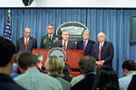 U.S. Secretary of Defense, Donald H. Rumsfeld, (background center), speaks to the media shortly after terrorist's crashed American Airlines flight 77 into the Pentagon 010911-D-SN666-033.jpg