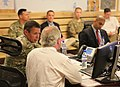 U.S. Sen. Bob Corker of Tennessee, foreground, attends a briefing on NATO Special Operations Component Command-Afghanistan operations with U.S. Army Maj. Gen. Scott Miller, left, while visiting Camp Integrity 130707-N-QV903-028.jpg
