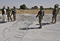 U.S. Soldiers with the 2nd Battalion, 23rd Infantry Regiment set up a traffic control point (TCP) in Panjwai district, Kandahar province, Afghanistan, May 23, 2013 130523-A-MX357-161.jpg
