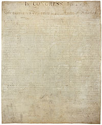 The original engrossed copy of the signed Declaration on display at the National Archives in Washington, DC.