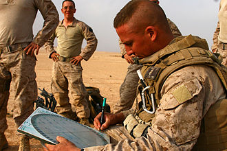 Indirect fire - A United States Marine lance corporal plots the direction and elevation of a mortar before firing.