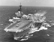 USS Independence (CV-62) at sea during the later 1980s or early 1990s (NH 97715)