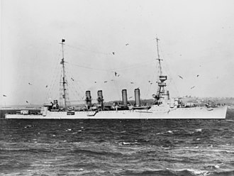 USS Omaha (CL-4) - Omaha in harbor, 8 December 1923, her lower twin torpedo tubes visible and her aircraft catapults installed.