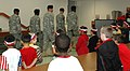US Army 51942 Soldiers of the Rear detachment flag team 15th STB, 15th SB, 13th ESC, perform drill and ceremony for students, family members and faculty at Clarke Elementary School during a ceremony to observe Patr.jpg