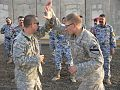 US Army 53442 BAGHDAD-San Benito, Tex. native, 1st Lt. Mike Olvera (left), uses his forearm to block Plant City Fla. native, Spc. David Croft's simulated knife attack during combined combatives training with their.jpg