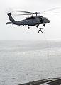 US Navy 020805-N-7871M-002 EOD Team Member repels from an SH-60.jpg