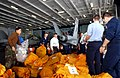 US Navy 021216-N-4953E-004 Postal Clerks and other Sailors sort mail in the ship's hangar bay aboard Truman.jpg