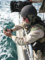 US Navy 030315-N-1050K-035 Machinist's Mate 3rd Class Donald Weber, a recalled reservist from Dubuque, Iowa, prepares to pull the pin on a concussion grenade he will drop in the waters of the North Arabian Gulf.jpg