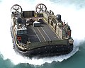US Navy 030331-N-8606T-004 Landing Craft Air Cushion Seventeen (LCAC 17) approaches the well deck of the amphibious assault ship USS Saipan (LHA 2).jpg