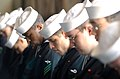 US Navy 030417-N-0252D-001 Sailors bow their heads in prayer during the memorial service for Lt. Nathan D. White at the U.S. Naval Air Facility Atsugi.jpg