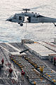 US Navy 030720-N-7781D-047 An MH-60S Knighthawk transfers ammunition from the flight deck of USS Harry S. Truman (CVN 75) to the Military Sealift Command fast combat support ship USNS Arctic (T-AOE 8) during a vertical replenis.jpg