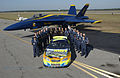 US Navy 031108-N-5862D-009 Members of the U.S. Navy Flight Demonstration Team, the Blue Angels, pose with the Navy Sponsored Chevrolet Monte Carlo Busch Series race car.jpg