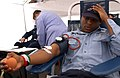 US Navy 040220-N-8273J-068 Operations Specialist Seaman Marlon McClain, of Los Angeles, Calif., donates blood during a USS Nimitz (CVN 68) command-wide blood drive on the pier next to the carrier.jpg