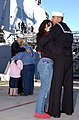 US Navy 050201-N-7397A-023 Sailors assigned to the guided missile destroyer USS Mustin (DDG 89) hug their families on the pier at 32nd Street Naval Station San Diego, Calif.jpg