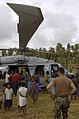 US Navy 050516-N-1485H-003 Crew members assigned to Helicopter Combat Support Squadron Five (HC-5) show off one of their MH-60S Seahawk helicopters to local villagers.jpg