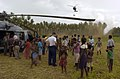 US Navy 050516-N-1485H-004 As one MH-60S Seahawk helicopter lands, crew members assigned to Helicopter Combat Support Squadron Five (HC-5) show off one of their MH-60S Seahawk helicopters to local villagers.jpg