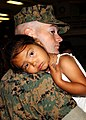 US Navy 050716-N-0716S-050 U.S. Marine Sgt. Kim Dewerff, assigned to the 13th Marine Expeditionary Unit (MEU), holds his daughter prior to leaving on a Western Pacific deployment.jpg