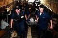 US Navy 050905-N-6436W-152 U.S. Navy Sailors carry an injured New Orleans citizen through the open well deck aboard the dock landing ship USS Tortuga (LSD 46).jpg
