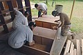 US Navy 051226-N-4374S-013 Sailors assigned to the guided missile destroyer USS Winston S. Churchill (DDG 81) assist with refurbishing old wooden cabinets.jpg