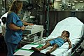 US Navy 060829-N-1577S-056 Aloha Medical Mission volunteer Patti Aylward embarked with the Medical Treatment Facility aboard the Military Sealift Command hospital ship USNS Mercy (T-AH 19), administers an EKG on a patient.jpg
