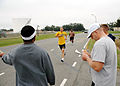 US Navy 061102-N-7427G-002 Yeoman 3rd Class Timothy Seidel sprints toward the finish line during the Physical Fitness Assessment (PFA) held aboard Naval Air Station Joint Reserve Base New Orleans.jpg